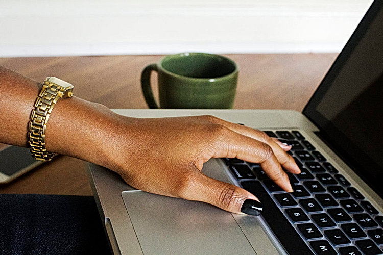 black-woman-hand-on-laptop-createherstoc