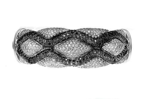 Black & White Diamond Criss-Cross Snake Pattern Bangle in 18 Carat white gold