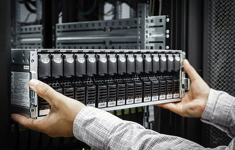 IT Engineer installs equipment in the ra