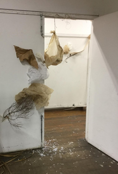 wall drawing (2018) found shredded documents, plant matter, dress patterns, string