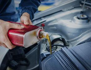 mechanic-changing-engine-oil-car-vehicle