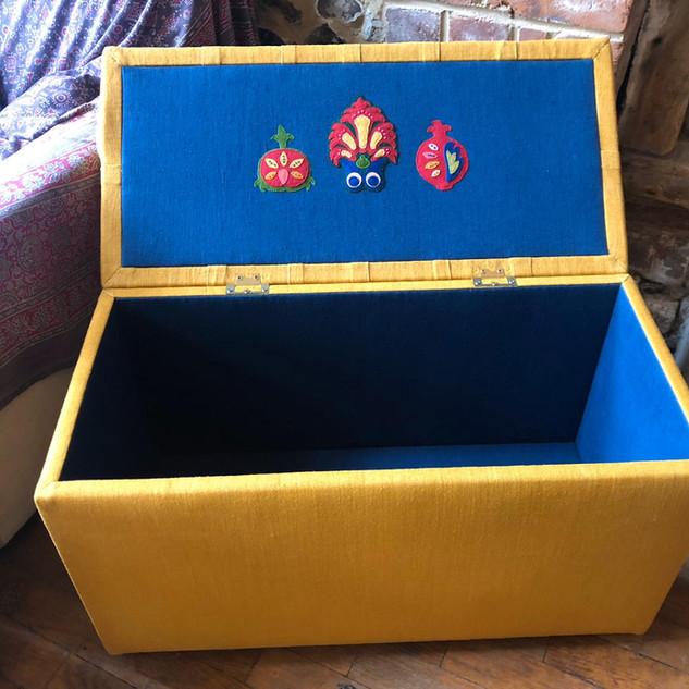 A finished ottoman box