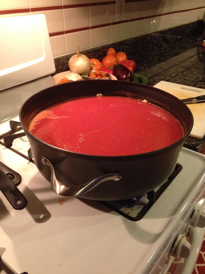 Tomato puree cooking down
