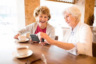 excited-old-ladies-watching-video-on-sma