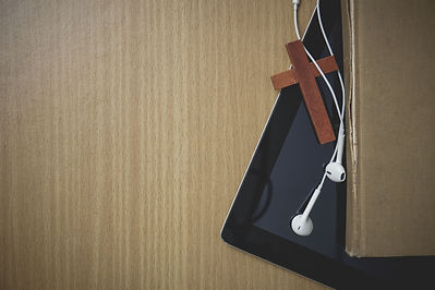 Table-with-Cross-Tablet-and-Earbuds.jpg