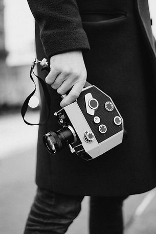 photo-of-a-man-holding-analog-camera-369