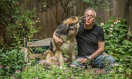 NYC dog training. UppeWell-behaved, happy dog West Side dog trainer Jay Andors with his dog