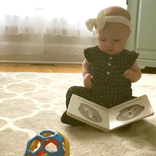 Baby reading Good Night Moon