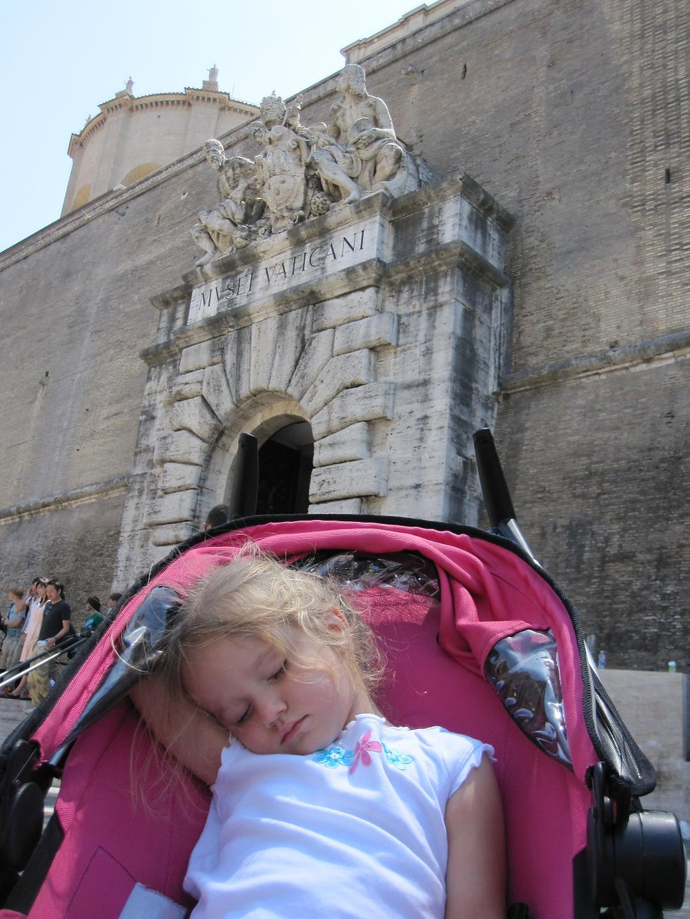 Toddler sleeping in stroller in Vatican City