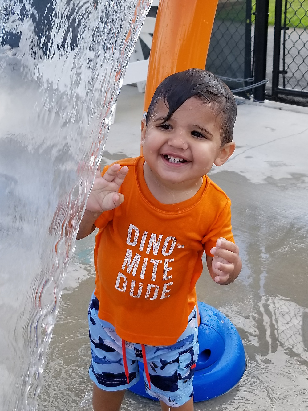 Toddler playing in the water