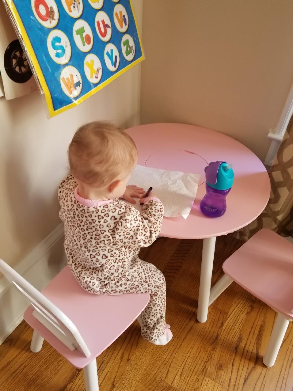 Baby writing at table