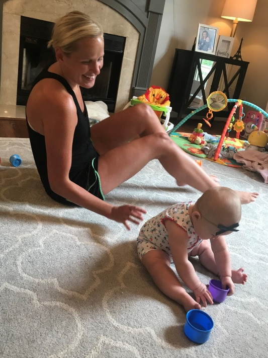 Mom and baby playing; floor time