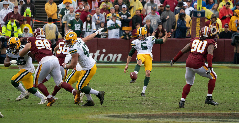 Packers punter JK Scott was supported by his team (photo: Keith Allison, flickr used with permission)