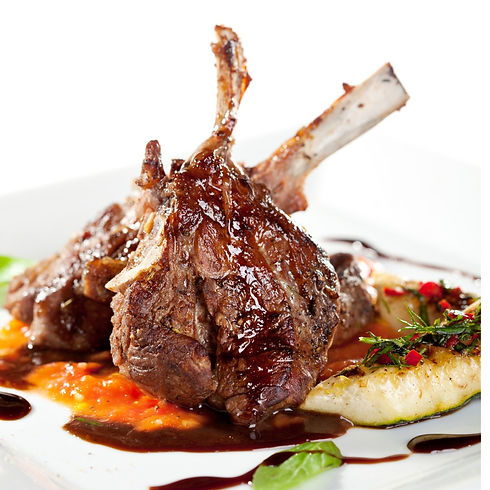 cooked-lamb-chops-with-vegetables-on-a-w