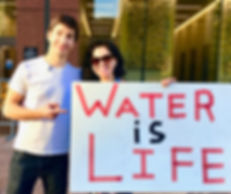 Alison Balbag & Justin Long standing for environmental & climate justice - Water is Life