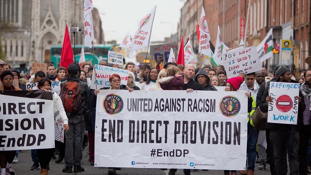 Image of protest calling for an end to Direct Provision at the Garden of Remembrance in Dublin