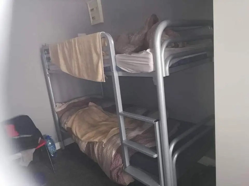 Room shared by six men (migrants or refugees) in Glenvera Direct Provision Centre in Cork city