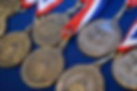 Medal_Promo-e1480534992970.jpg