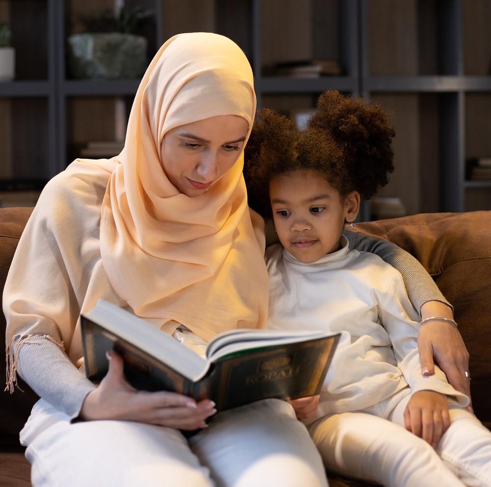muslim family, reading Quran, muslim mother and daughter