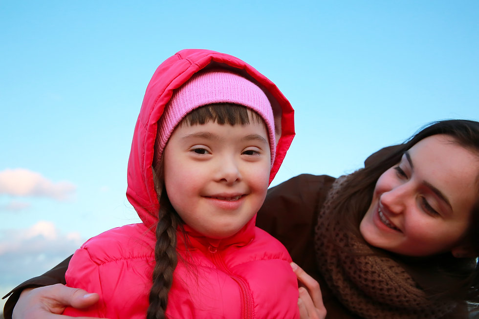 Girl with special educational needs smiling into the camera