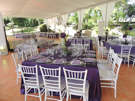 this a wedding in miami with white chiavari chairs and a pretty nice decoration with flowers lights and beautiful center pieces hand made