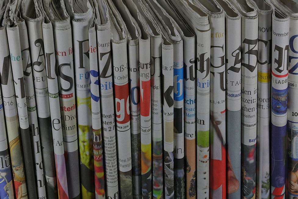 row of newspaper spines