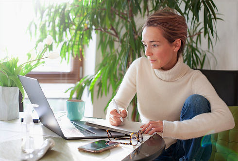 Woman at desk using laptop
