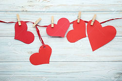 95404842-red-paper-hearts-hanging-on-rib