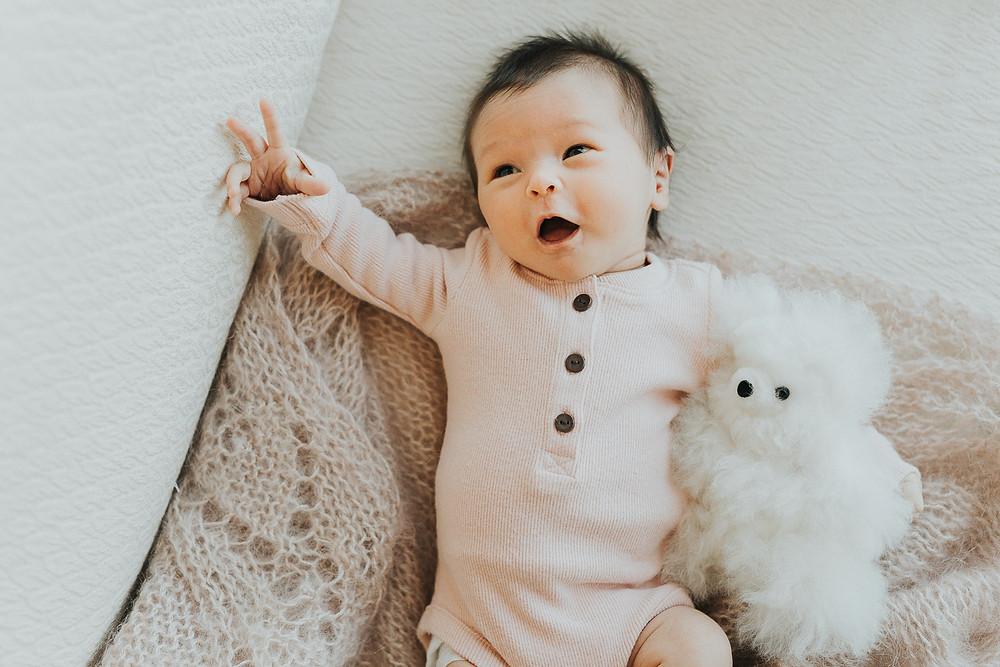 Newborn baby with stuffed animal