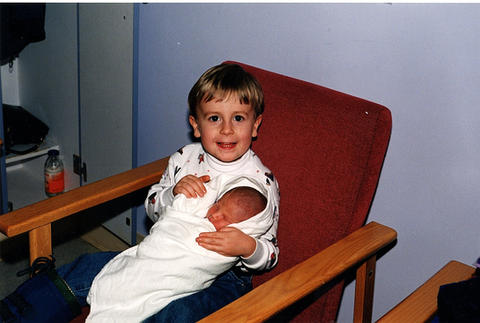 1998 Luke holds his brand new baby brother Ethan