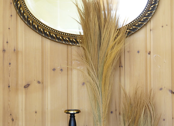 Oval mirror in golden frame