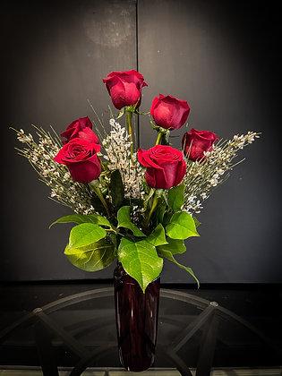 HALF OF DOZEN RED ROSES IN RED VASE