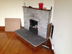 Fireplace in lounge (before)