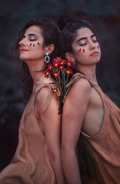 Two Women With flowers on face Artistic