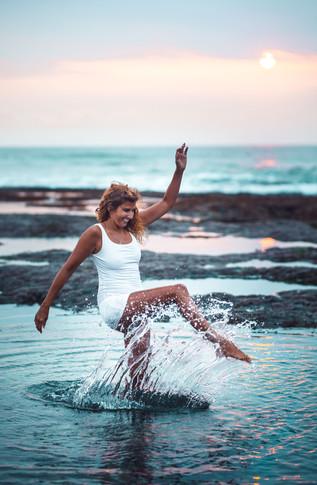 Woman kicking Water Portrait Photography