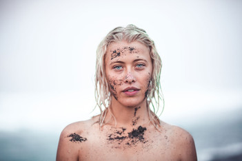 Woman covered in beach sand Portrait Pho