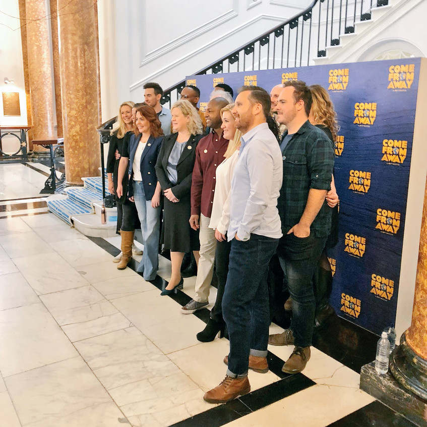The cast gather for a photo call