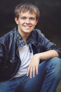 Teen boy in leather jacket and jeans, portrait Georgia