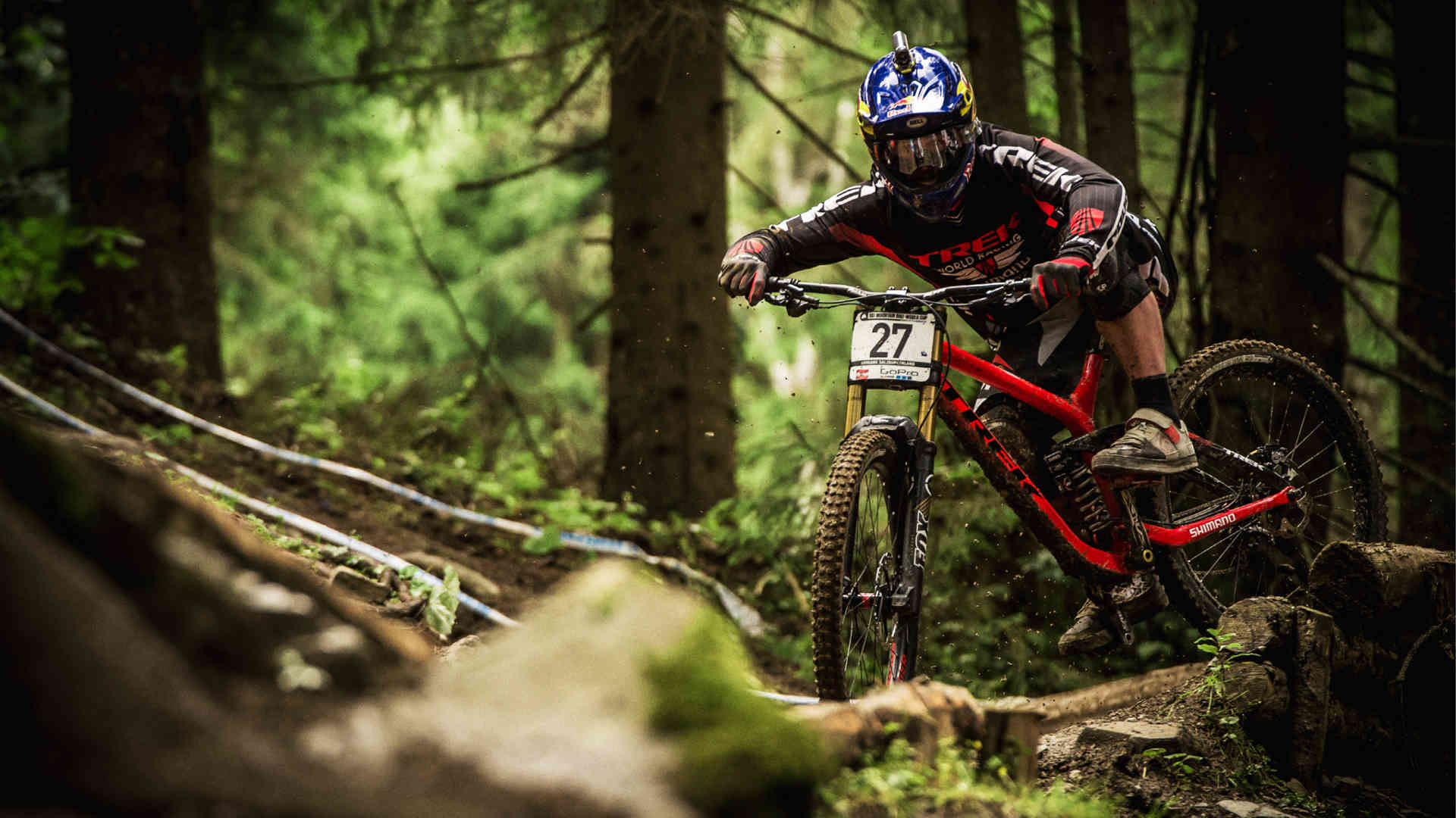 man riding a downhill bike