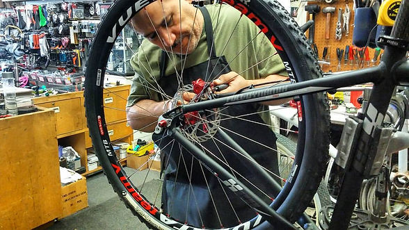 Willy from Willy's Bikes Repairing a Wheel