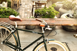 bicycle leaning against a wooden wall