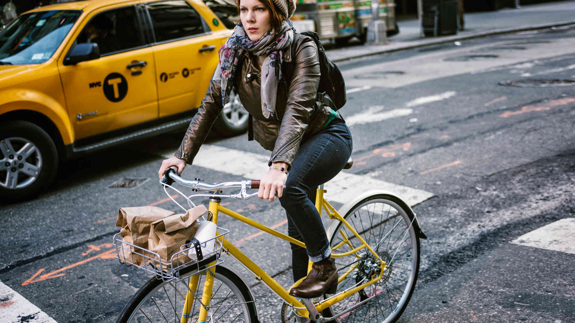 woman riding a city bike in NY city