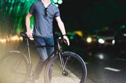 man walking next to his bicycle