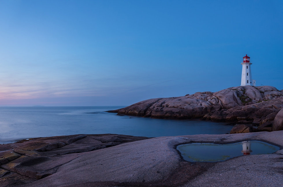 Peggy's Cove lighthouse at dusk. The ligthouse represents the Pharosity Consulting brand as a managed markets consulting leader.