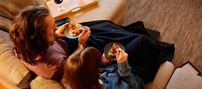 Couple eating on couch.jpg