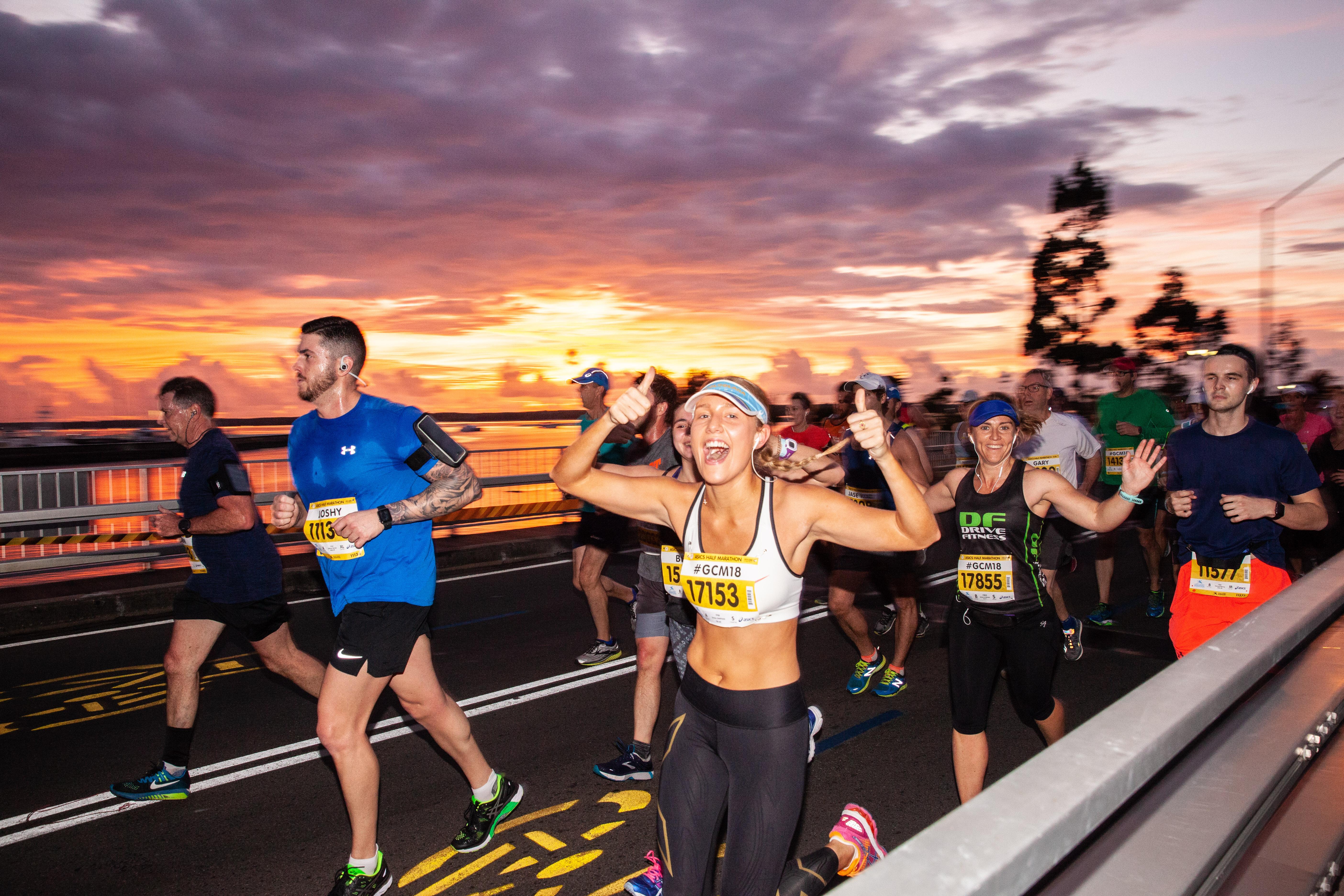 GCM19 21km sunrise with runner giving th