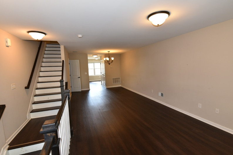 102 - LR, Dining Area, Stairs to second