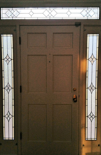Sidelights and Transom with Solid Door