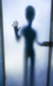 UFO silhouette behind the glass door.jpg