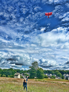 Flying a kite in the Kilmacolm Meadow